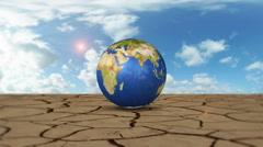Orbiting Earth Globe On Cracked Desert Stock Footage