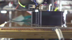 Affordable 3d printer printing with black plastic filament, 4K shot Stock Footage