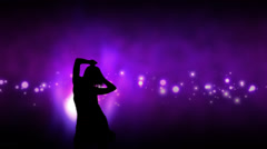 Young female silhouette dancing in slow motion Stock Footage