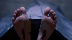 Deceased Mans Feet with Wounds and Toe Tag - Pan Top to Bottom Stock Footage