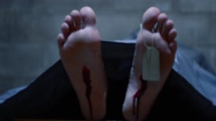 Deceased Mans Feet with Wounds and Toe Tag - Pan Stock Footage