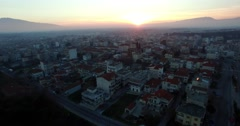flight above the town of Dramas in northern Greece at sunset Stock Footage