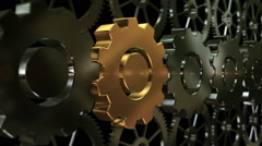 Zoom to the gold plated machine gear Stock Footage