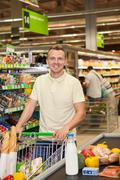 Man shopping in a supermarket Stock Photos