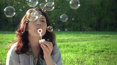 Cute Girl Blowing Soap Bubbles In Park Stock Footage