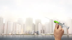 Hand Holding Green Injector - City Scene Stock Footage