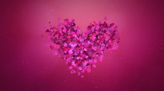 Small particles forming big heart shape Stock Footage