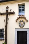 Cross on the wall of church facility in Bavaria - stock photo