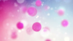 Spheres slowly moving on colorful background Stock Footage