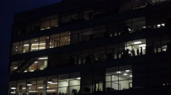 Pan down of office building at night Stock Footage