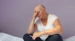 Devastated young woman ill with cancer is reading bad medical test results Stock Footage