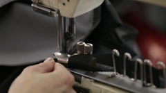 Hand sewing on a machine Stock Footage