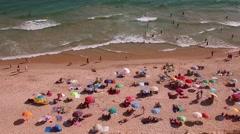 People in beach having sunbath - Falésia beach  Algarve Portugal 120 FPS Stock Footage