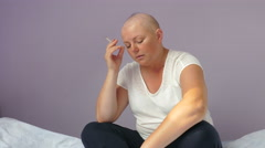 Angry, devastated young woman ill with cancer is reading bad medical test result Stock Footage