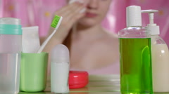Young girl cleaning face skin with soft cotton pad in bathroom Stock Footage