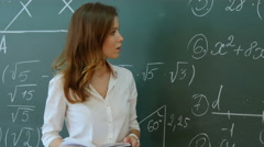 Teacher Standing In Front Of Class Asking Question and smiling Stock Footage