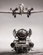 Steamengine and a biplane with a airscrew Stock Photos