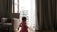 Child Playing Hide and Seek, Happy Little Girl Playing with Curtains, Children Stock Footage