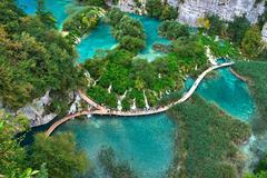PLITVICE, CROATIA - JULY 29: Tourist enjoy sightseeing the lakes and wonderfu Stock Photos
