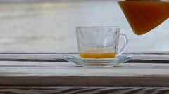 Hot drink of sea-buckthorn in glass cup Stock Footage