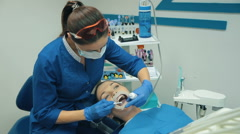 Woman at the dentist treats a teeth Stock Footage