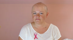 Women ill with breast cancer is smiling to camera. Hope Arkistovideo