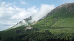 Boiling of Clouds Over the Mountain Pass. Timelapse Stock Footage