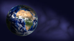 Orbiting earth on blue background Stock Footage