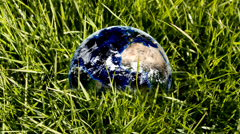 Orbiting earth in green nature Stock Footage