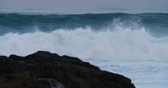 Massive blue waves roll into the coast of Hawaii in slow motion. Stock Footage
