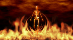 Scary skeleton walking in the flames Stock Footage