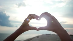 Hands show heart at sunset, love Stock Footage