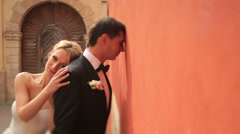 Beautiful happy blonde bride touched lovingly her thoughtful groom. Sunny Lviv Stock Footage