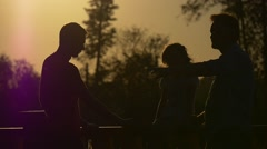 Man Silhouette Raises Hand Pointing Somewhere Sunny Evening Sunset Family in Stock Footage