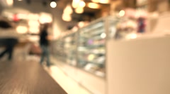 Brunette girl choosing chocolates in pastry shop. 4K background bokeh video Stock Footage
