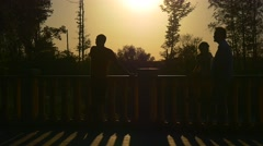 People Silhouettes in Large Sun Disk Family Park Bridge Dad Grandfather Kid Stock Footage