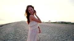 Loving girl sends an air kiss on the beach Stock Footage