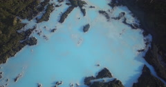 Aerial pan up from turquoise water to the Blue Lagoon Stock Footage