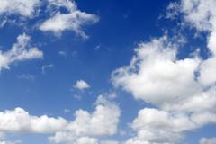 Fluffy clouds in a blue sky Stock Photos