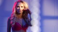 Attractive blond lady wearing sexy underwear Stock Footage