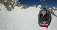 Cable cars from Pointe Helbronner in Italy to Aiguille du midi in France. Stock Footage