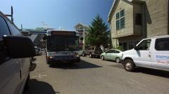 A City Bus And A Ketchikan Duck Tour Amphibious Vehicle In Ketchikan Alaska Stock Footage