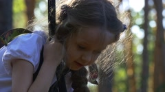 Girl Checks Her Own Skills in a Tree-Climbing Stock Footage