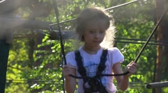 Girl is in Adventure Rope Park is Summer Day Child Has Fun Occupied by Sport Stock Footage
