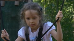 Rope Park Brave Little Girl in Adventure Park Safety Belts Are Fixed on Kid's Stock Footage
