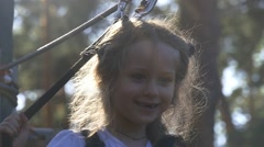 Girl Managed to Climb on a High Tree Stock Footage