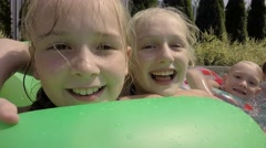 Happy children swimming in the pool. Slow motion. Stock Footage