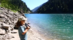 Small hiker looks the view with binoculars Stock Footage