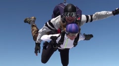 Skydiver with passenger in  tandem freefall Stock Footage