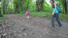 Small child walking in the forest. Trips to nature. Community children with Stock Footage
